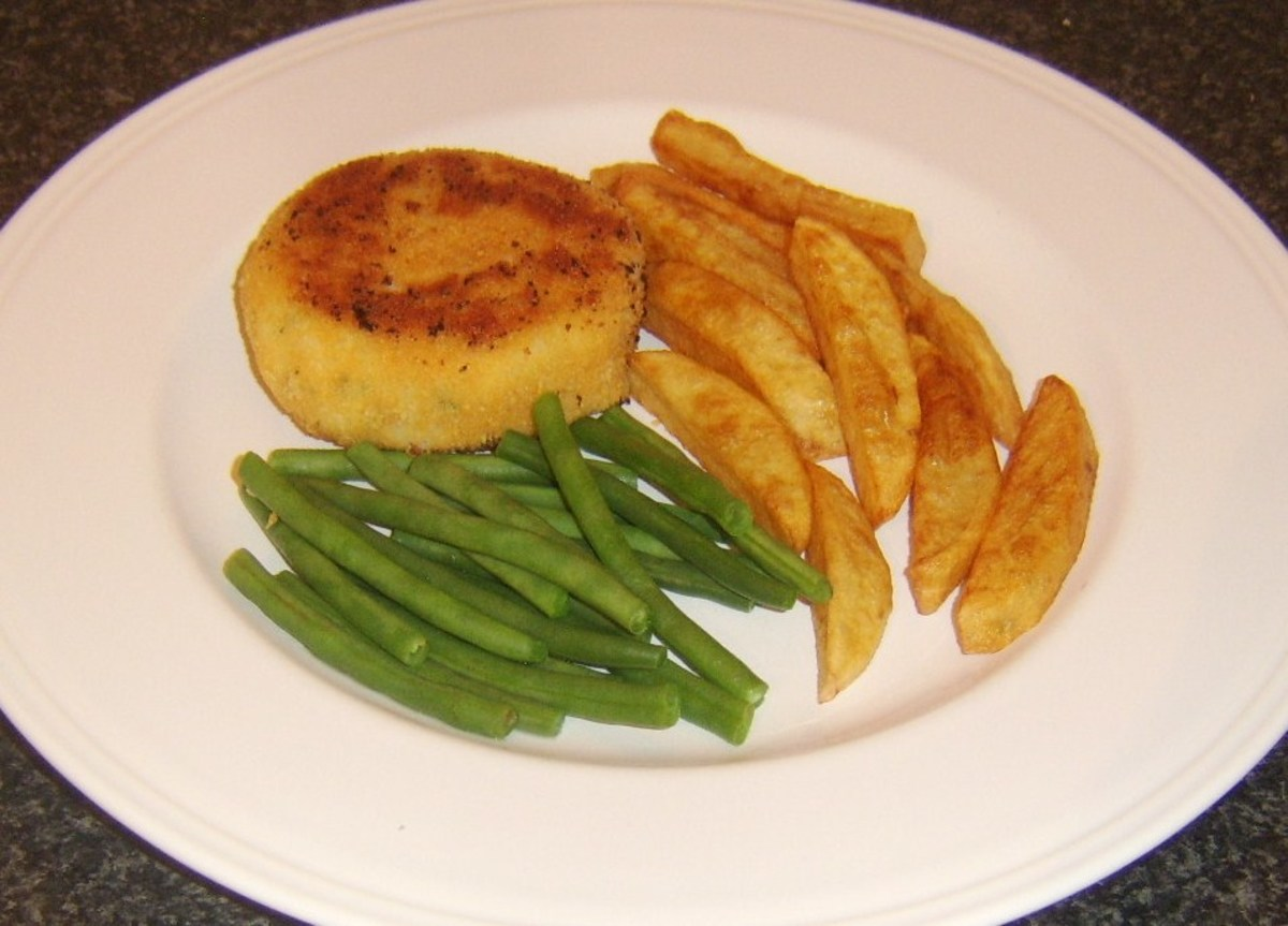 Pollack and herb fishcake served with homemade chips and green beans