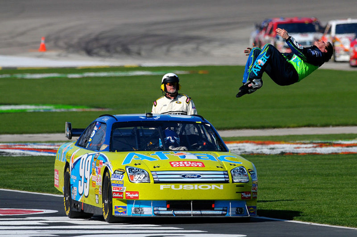 NASCAR driver Carl Edwards doing his celebratory back flip after winning a race in Texas.