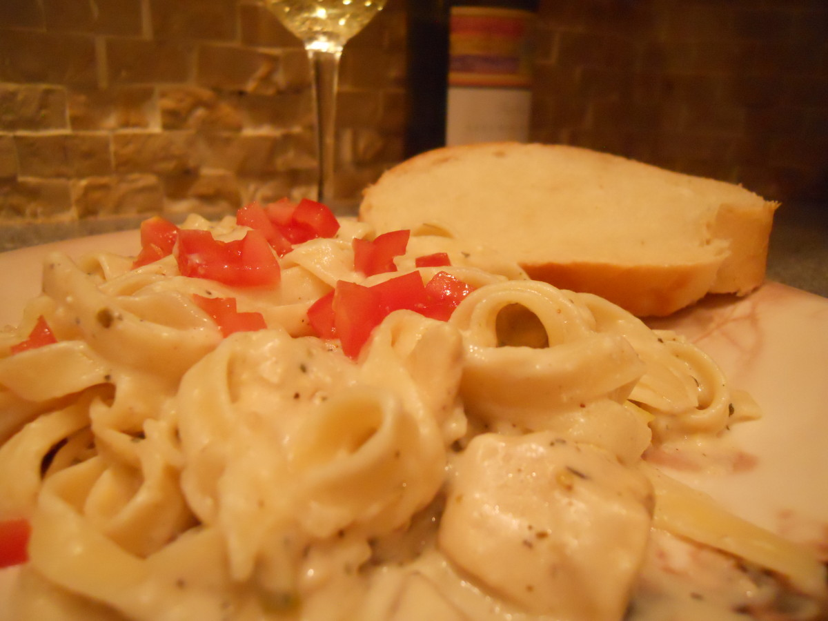 Serve chicken fettuccini alfredo with bread, salad and, perhaps, a nice pinot.