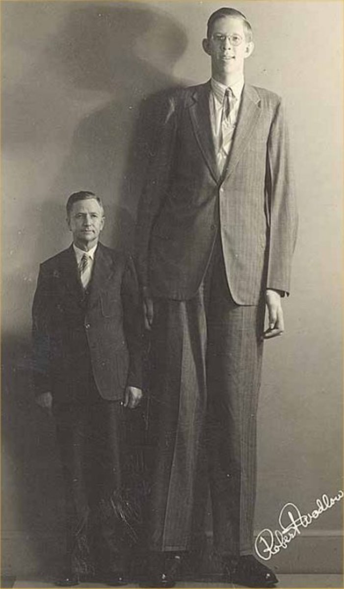 "Robert Wadlow, who, at 8' 11"", is the tallest person in recorded history. His height was due to a pituitary gland disorder which produced abnormal levels of human growth hormone (HGH)."