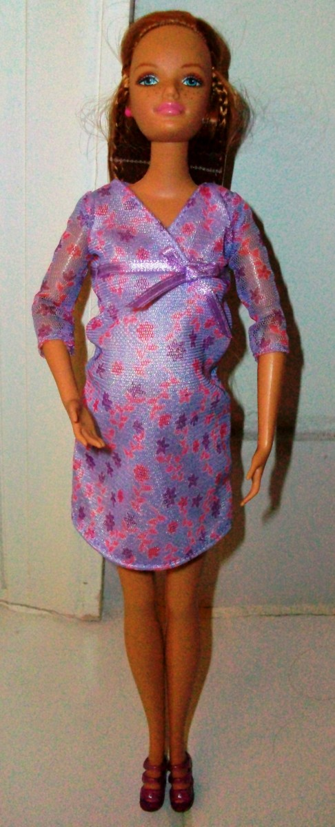 Pregnant Midge, Barbie's friend in her purple flowered dress. Just look at that tummy!