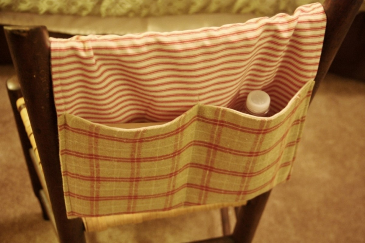 Here is the finished walker tote, hanging over a chair as it would hang over the bar of a walker.