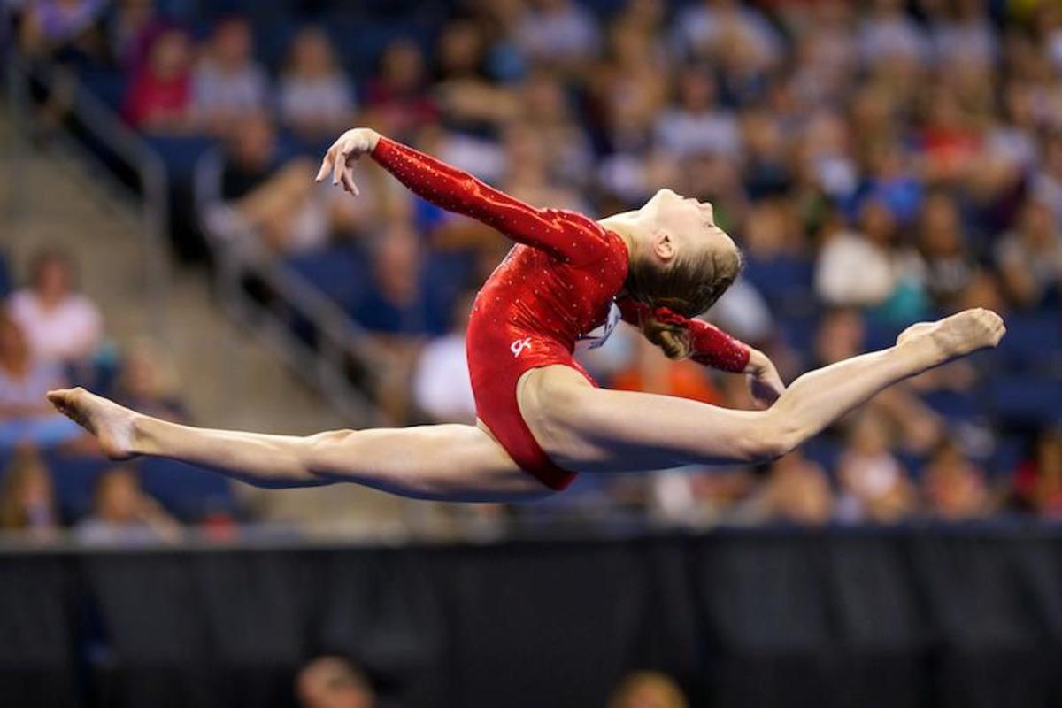 Madison Desch started her gymnastics career as a gymnast with me! Madison is performing a switch-ring leap.