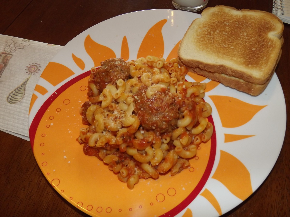 Italian meatballs with elbow noodles and homemade garlic bread.