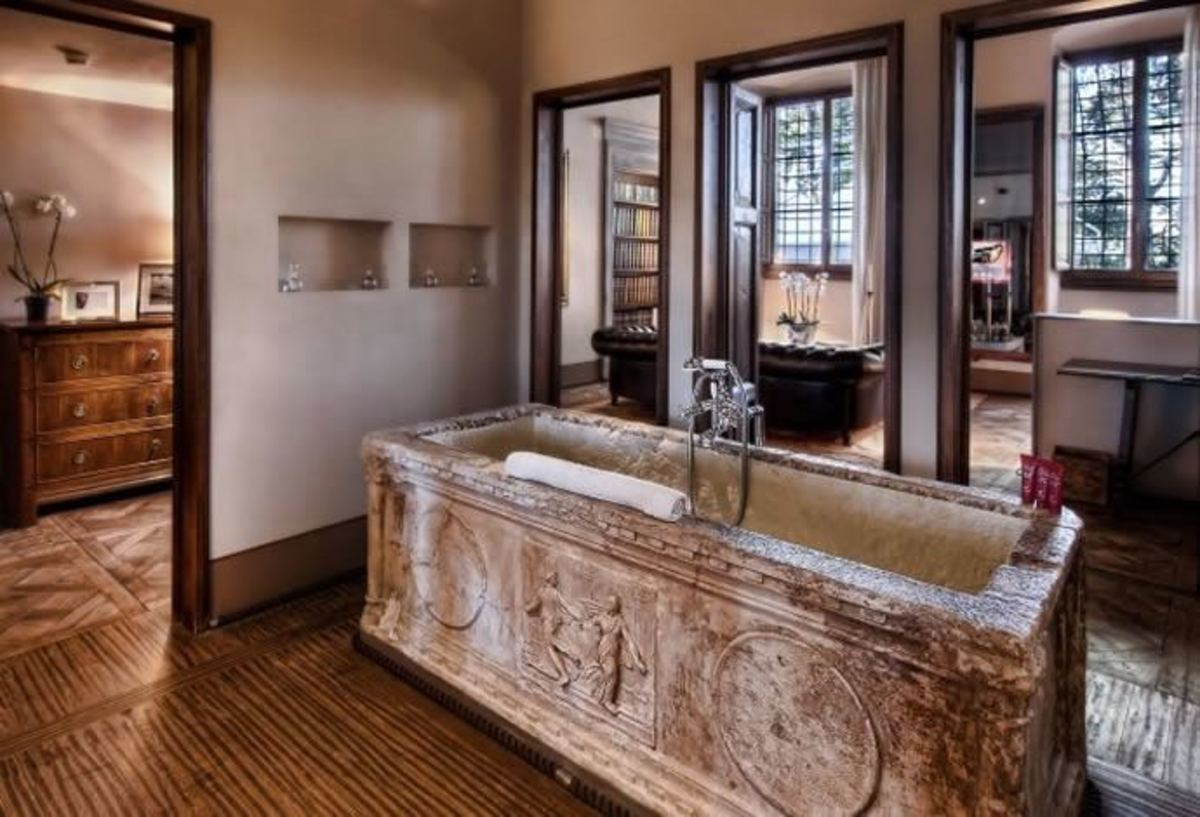 It doesn't have to be this extravagant (from the Affresco Suite at the hotel Il Salviatino in Florence, Italy) but stone baths are always beautiful.