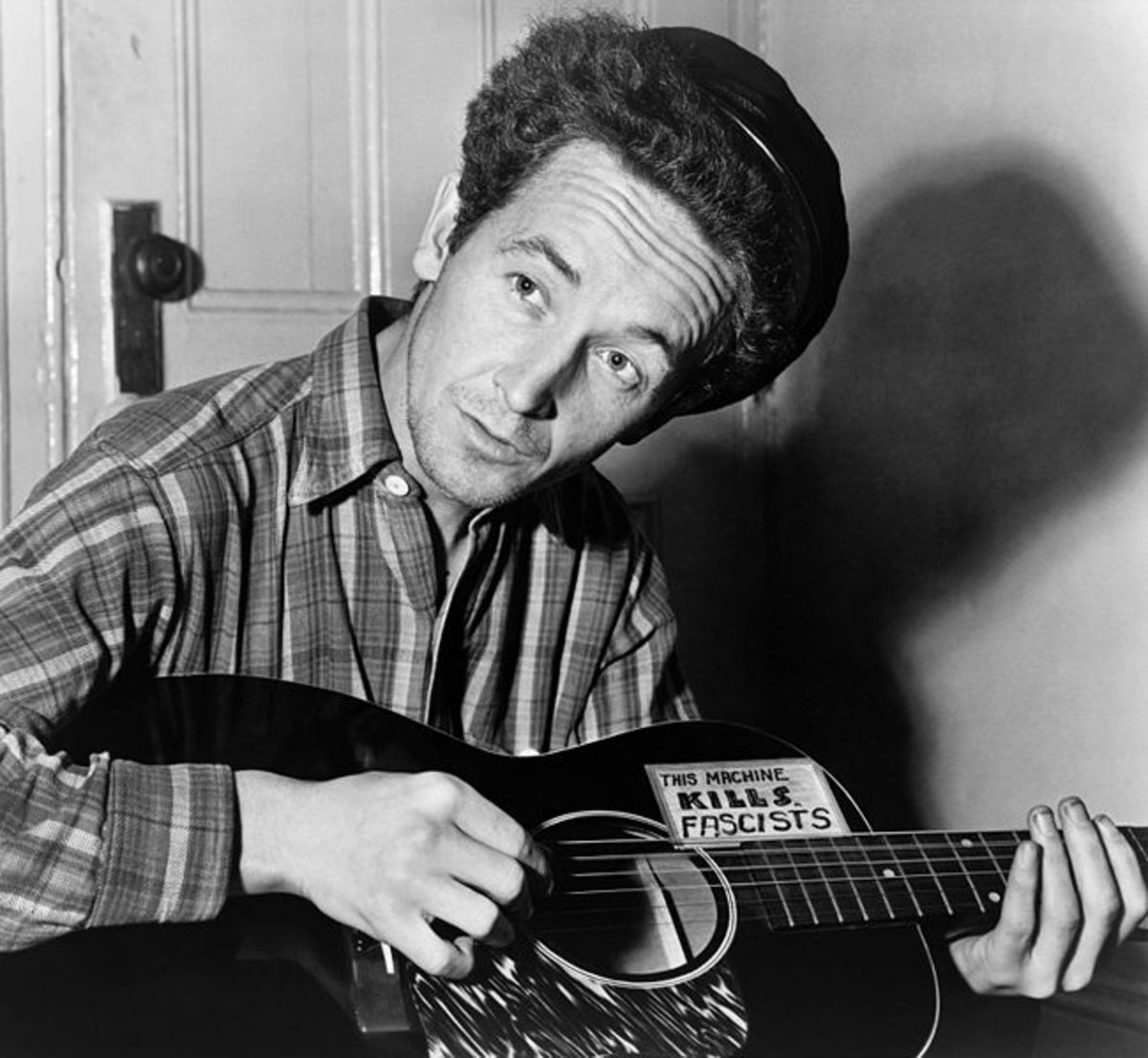 Woody Guthrie This Machine Kills Fascists Folk Singer Armed With His Weapon
