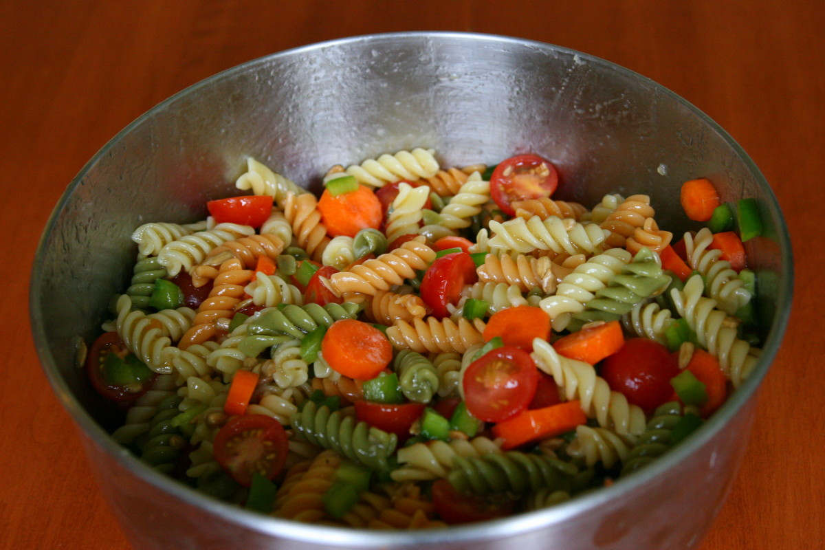 This pasta salad recipe includes rotini pasta, Italian dressing, vegetables, and sunflower seeds.