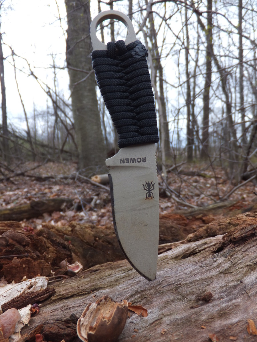 The Esee Izula is a compact neck knife perfect for backpacking and survival.