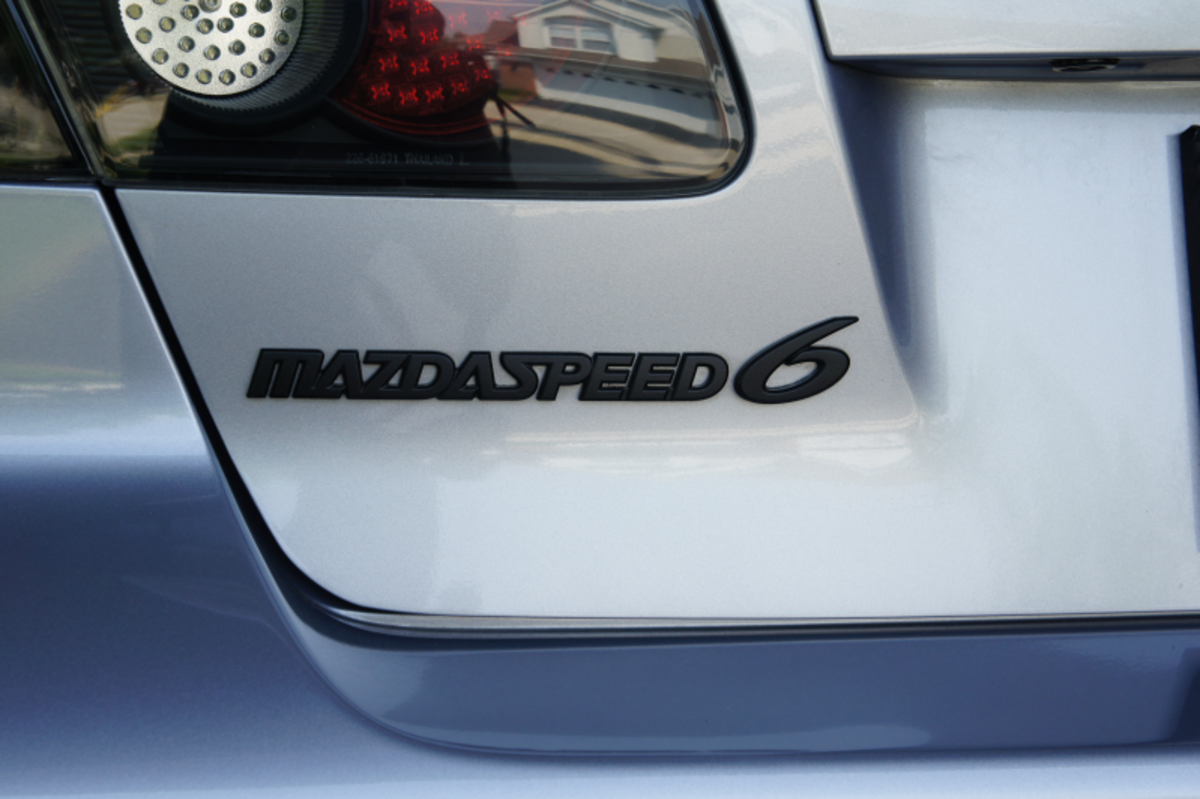 A Plasti Dip coated Mazdaspeed6 emblem