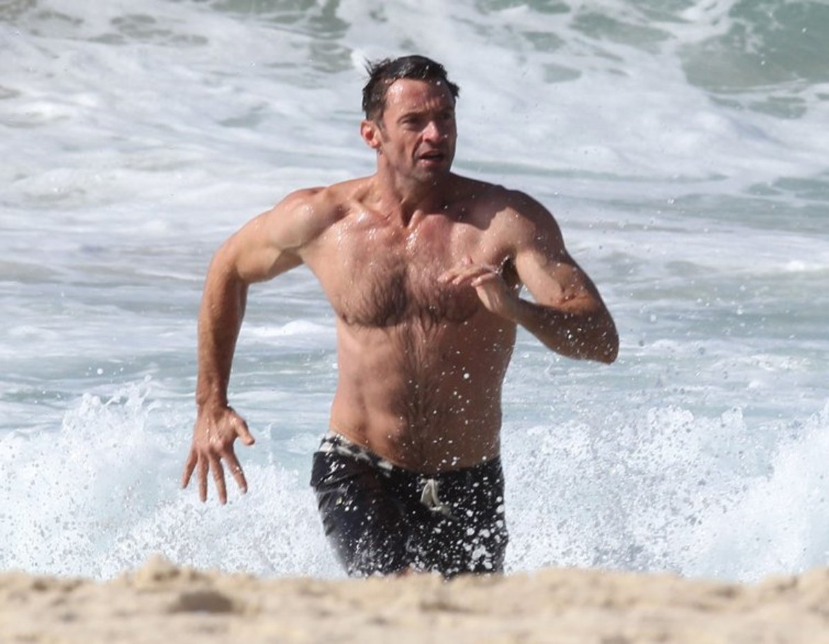 Shirtless Hugh Jackman on Bondi Beach. He may not be the guy with the biggest body in tinsel town but his muscular and well proportioned body is definitely eye candy for the fairer sex.