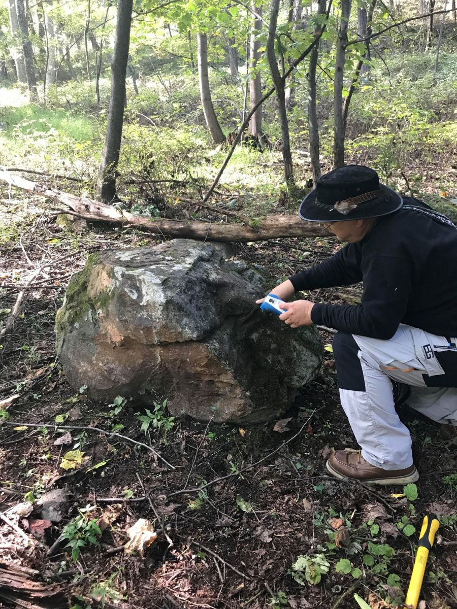 "Matthew ""Maasaw"" Howard is cleaning off the lichen of the rock on his property to reveal something spectacular."