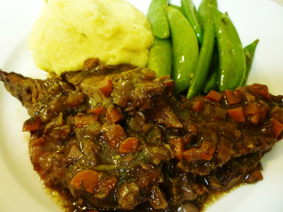 Brasato served with creamy polenta and sugar snap peas.