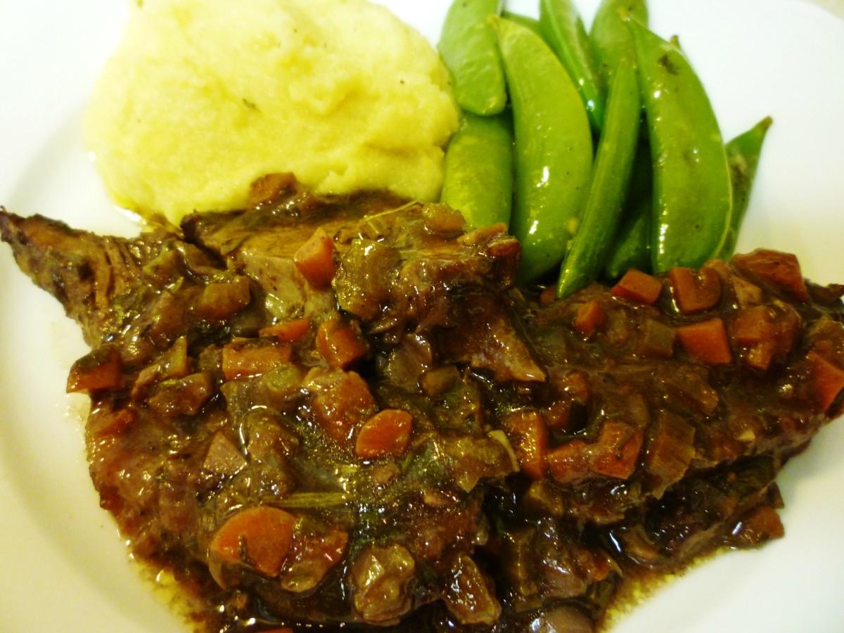 Brasato served with creamy polenta and sugar snap peas.