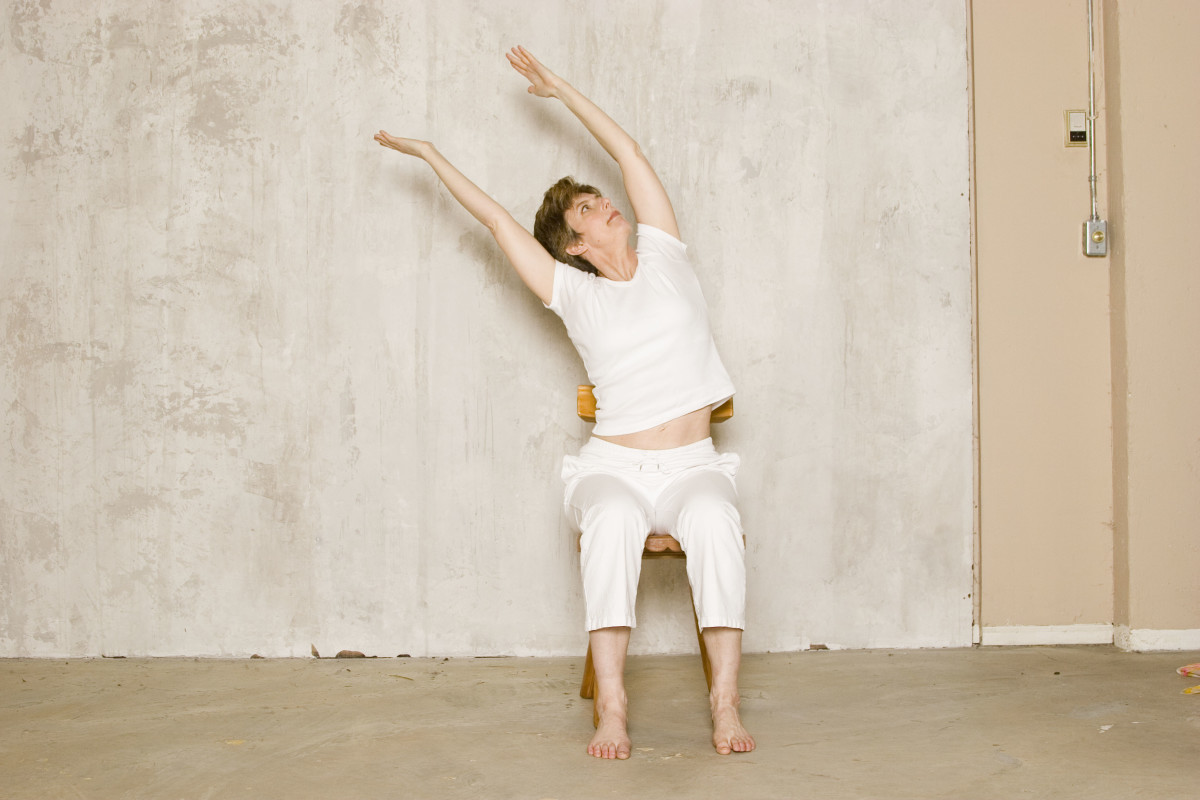 Seated Willow. As you inhale, reach up through both arms while relaxing the shoulders down.  As you exhale, deepen the side stretch.