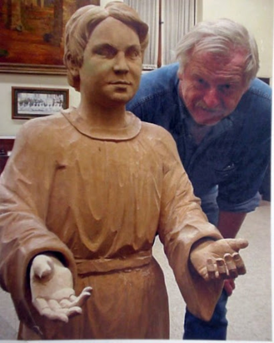 Jorg Hummel, Master Carver with his carving of Jesus Christ at 13 years of age.