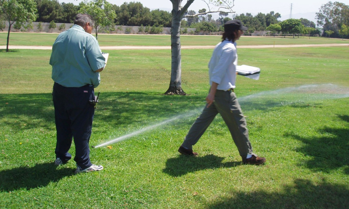 Conducting an irrigation audit includes checking each sprinkler to make sure it's spraying properly, then taking notes on what needs to be corrected.