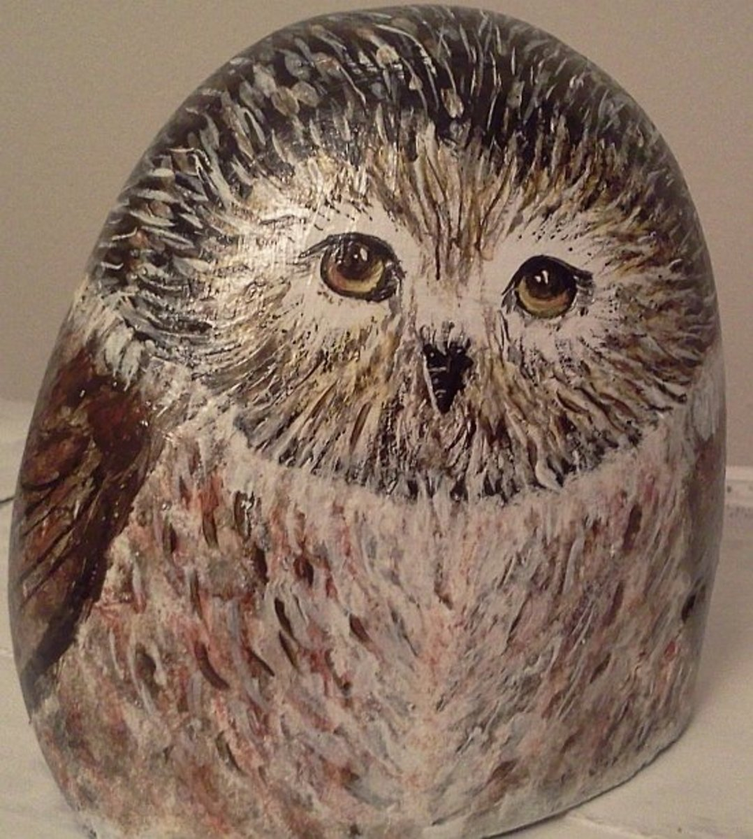 Pebbles that have broken in half are perfect for owls.