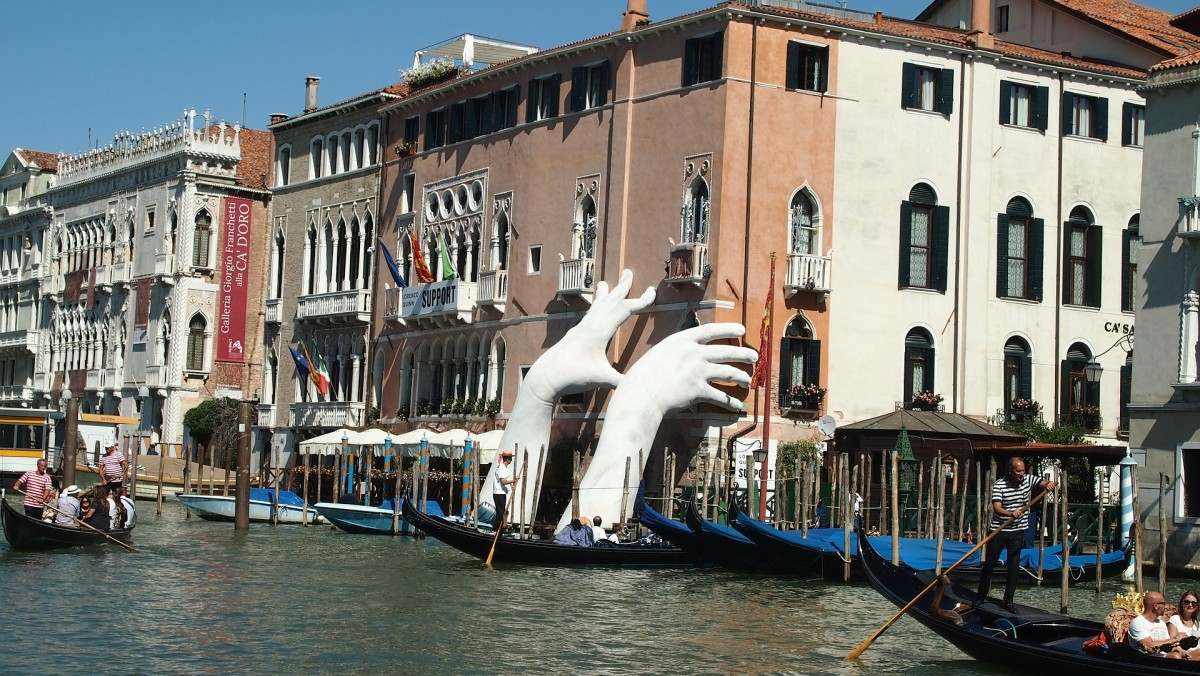 Lorenzo Quinn's Sculpture in Venice highlights the threat of climate change. The big hand installation was on view in the Grand Canal from May-November 2017.
