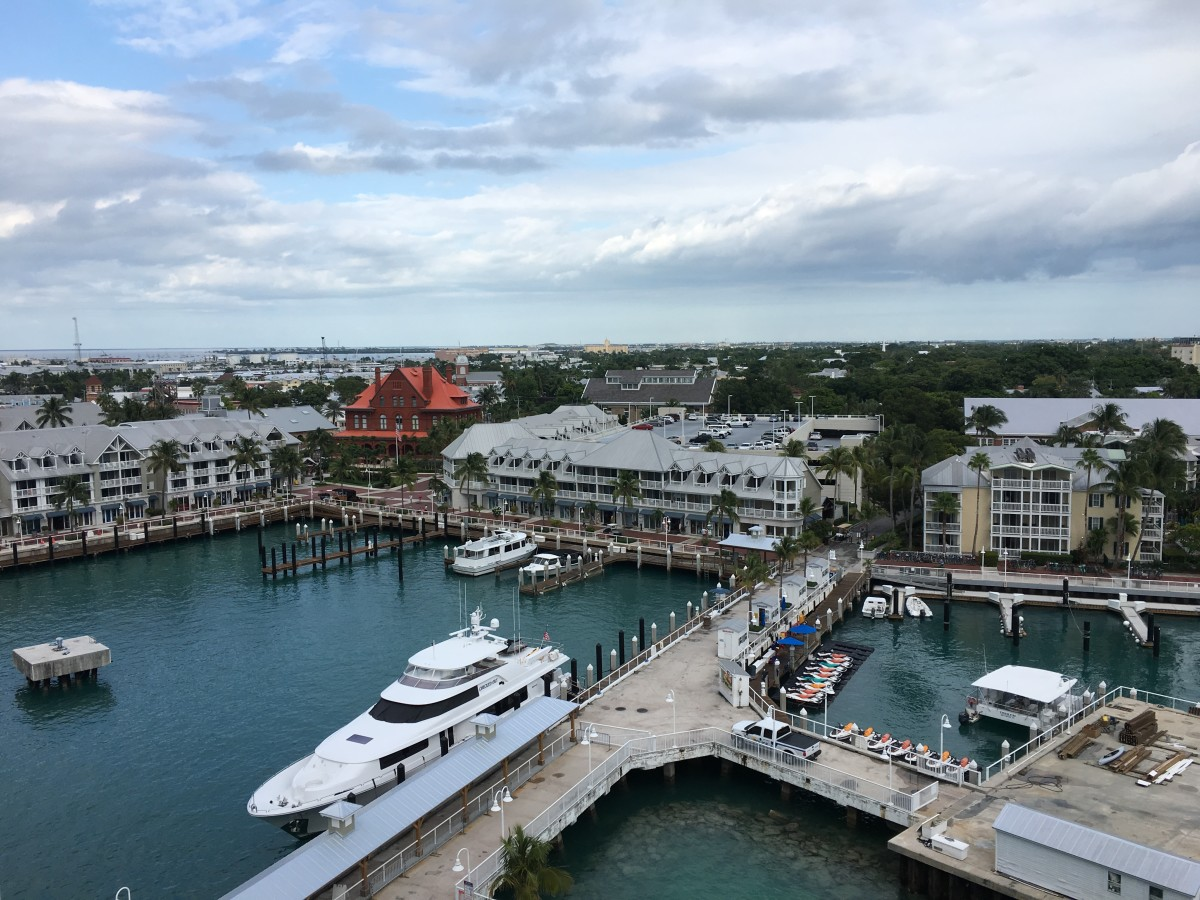 The harbor area of Key West. The city  is the most populated city in the Florida Keys. The island of Key West is at the southernmost tip of the Florida Keys and is located around 90 miles from Cuba.