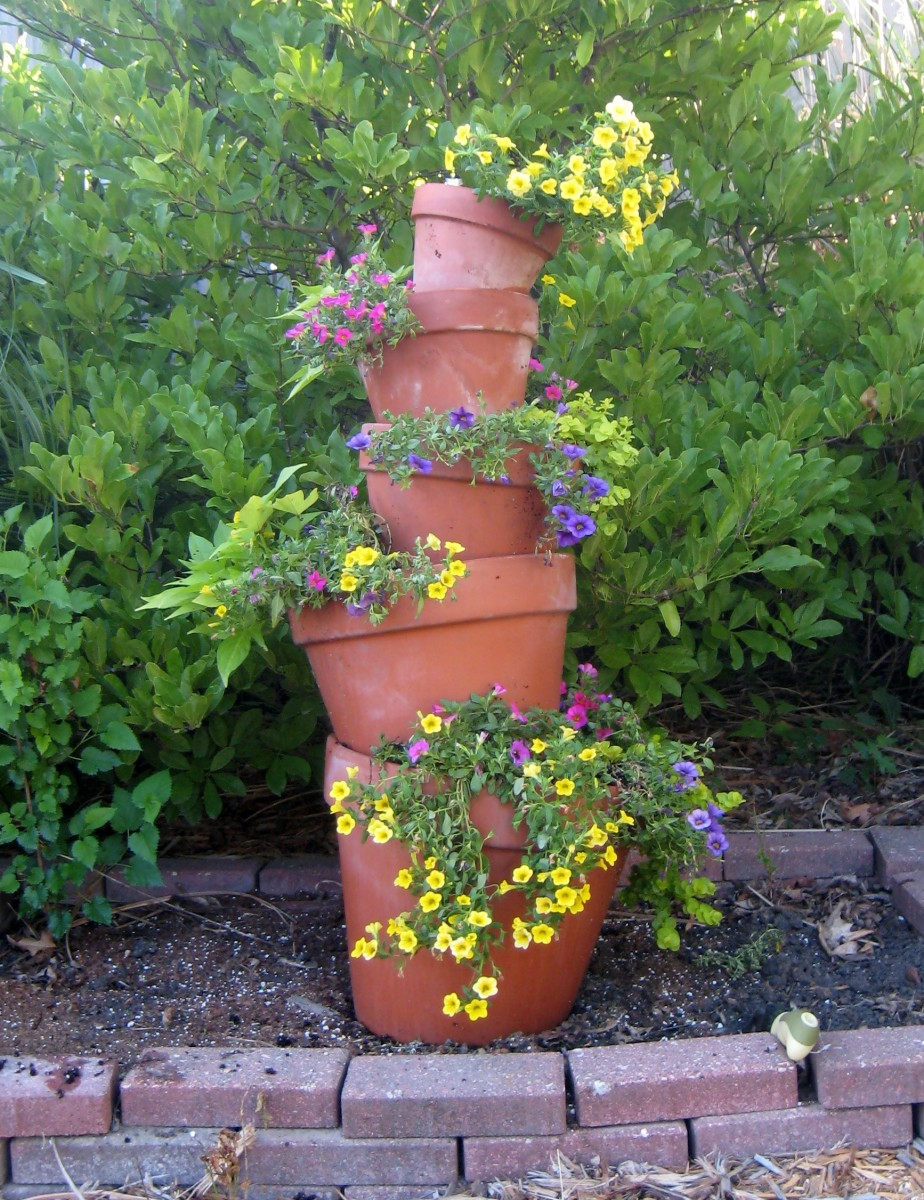Flowers cascade down this beautiful crooked flower tower of annuals.