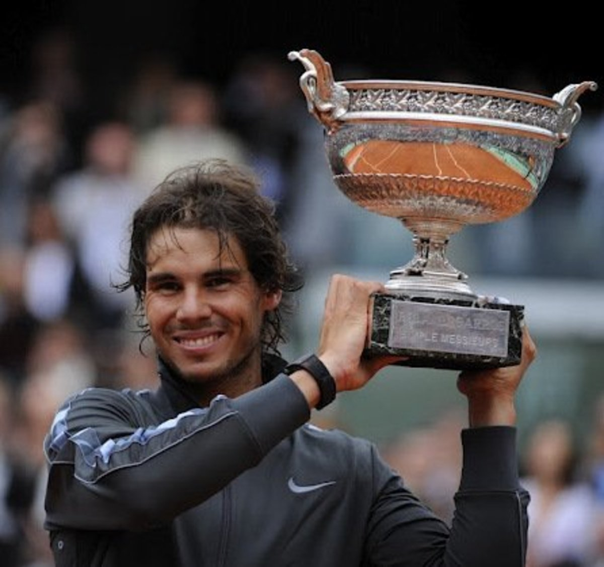Nadal with the 2012 French Open Champions Trophy.