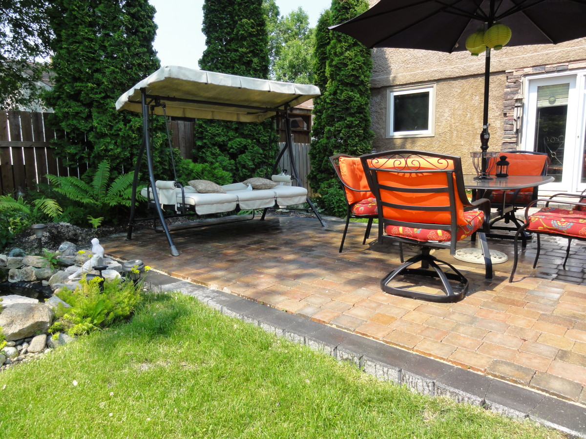 This guide will show you how to put together your own maintenance-free paving stone patio.