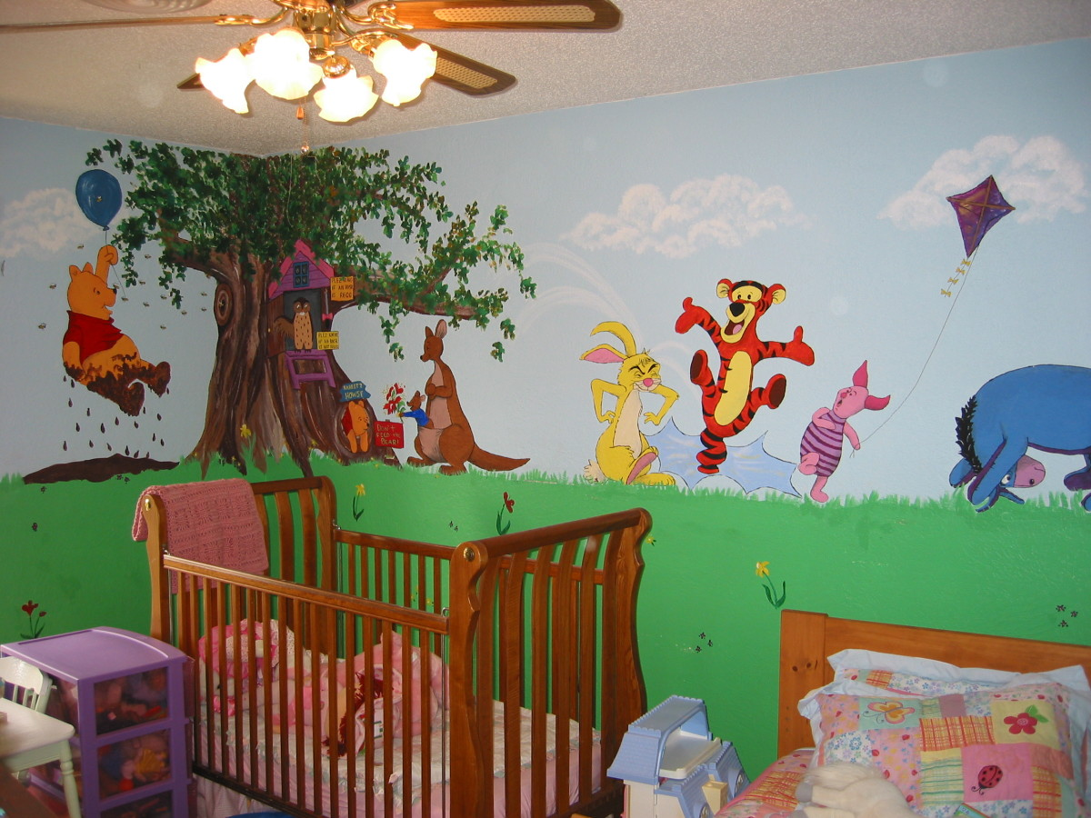A tree wall mural is great all on its own. It looks terrific in a corner. I used sponges shaped like leaves and dipped them into two colors of green paint.