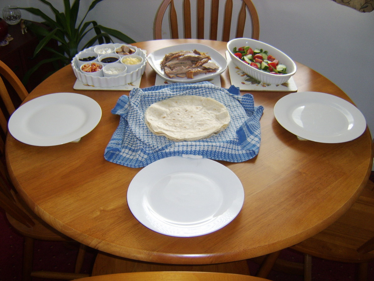 Roast turkey thigh, salad, wraps and various condiments and accompaniments are all taken to the table for everyone to help themselves.