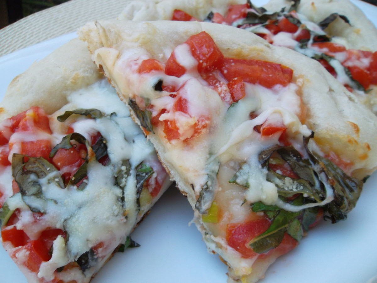 Pizza Margherita—an easy homemade pizza recipe for gas grilling or the oven.
