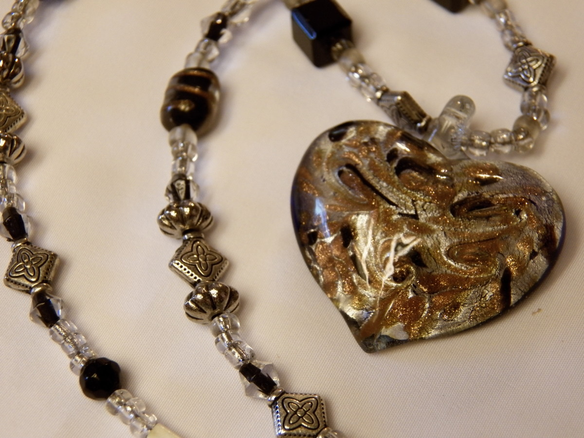 Beaded necklace with glass heart.
