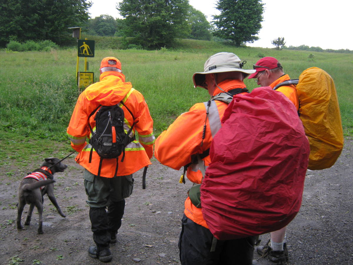 SAR team members get ready to conduct a hasty search for a lost person.