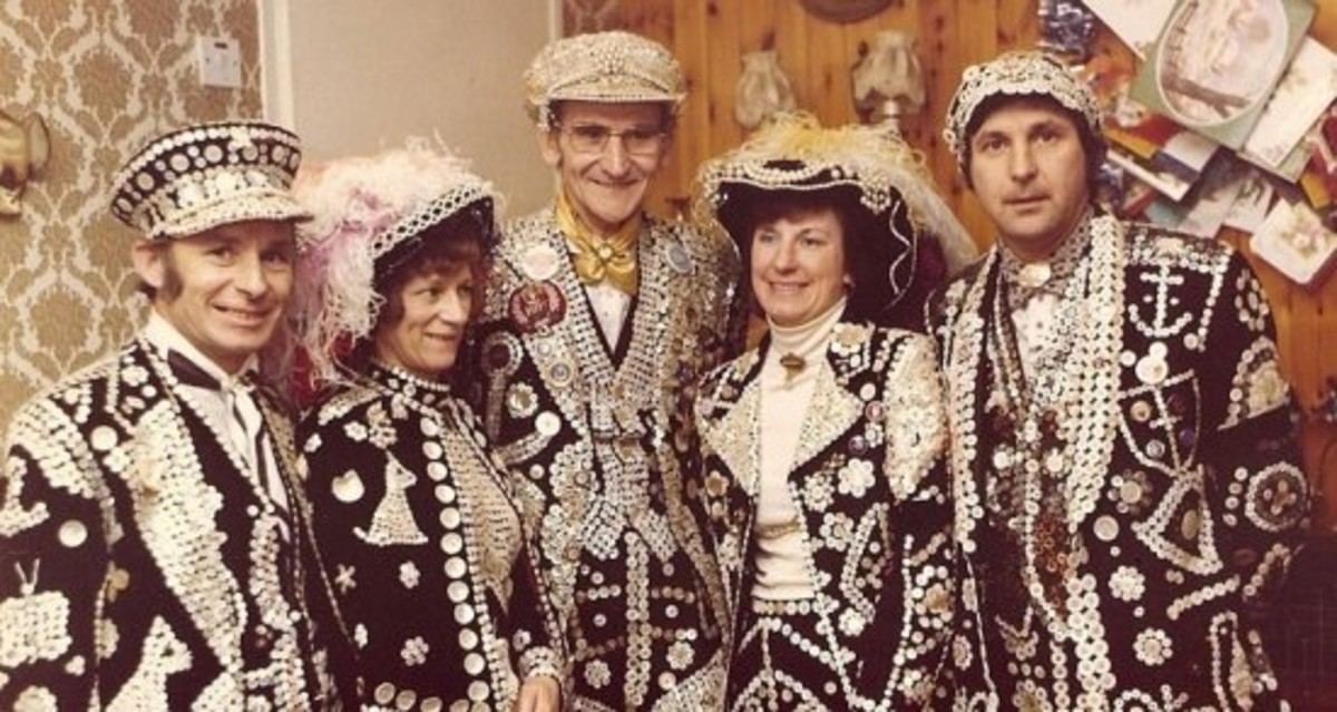 Pearly Kings and Queens wear ceremonial suits covered in pearl buttons.