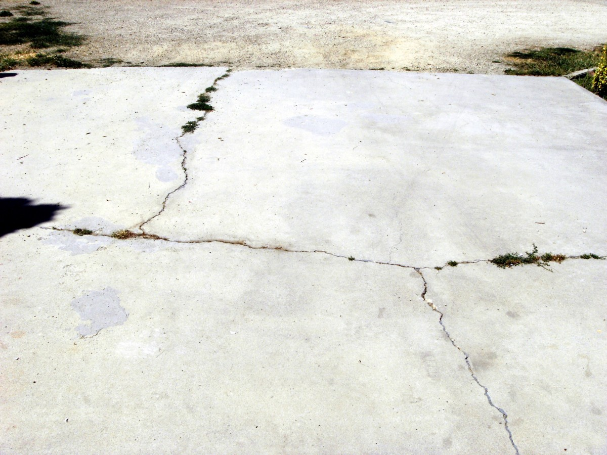 This concrete drive is badly cracked and in desperate need of repair.