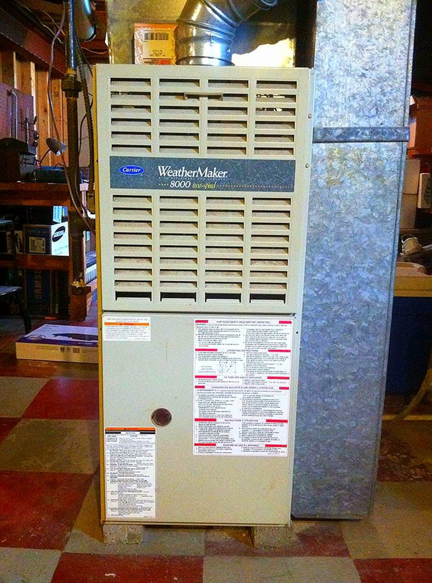The return air drop, a common location for oil-canning, is on the side of this furnace; in a furnace that blows downward, the return air drop will be connected to the top.