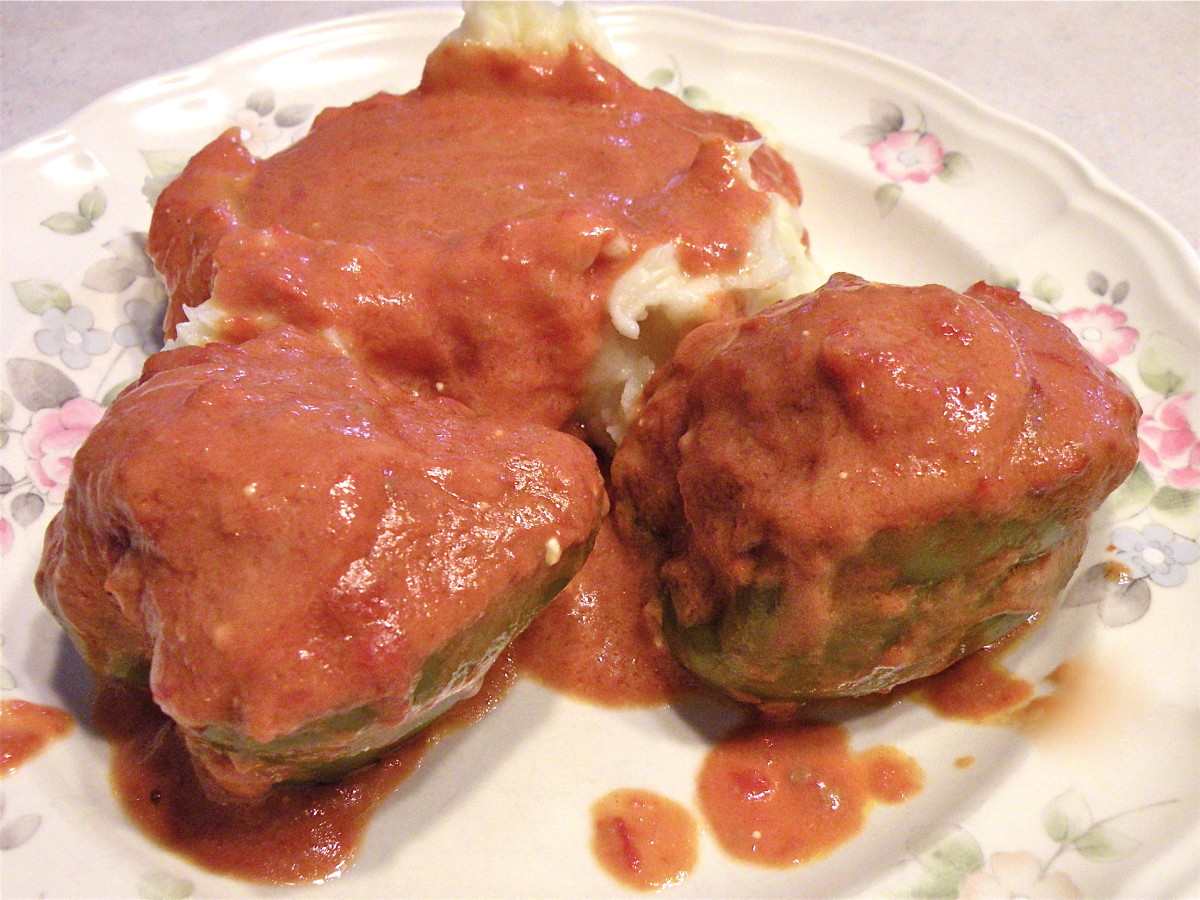 Hungarian stuffed peppers with tomato gravy and mashed potatoes.