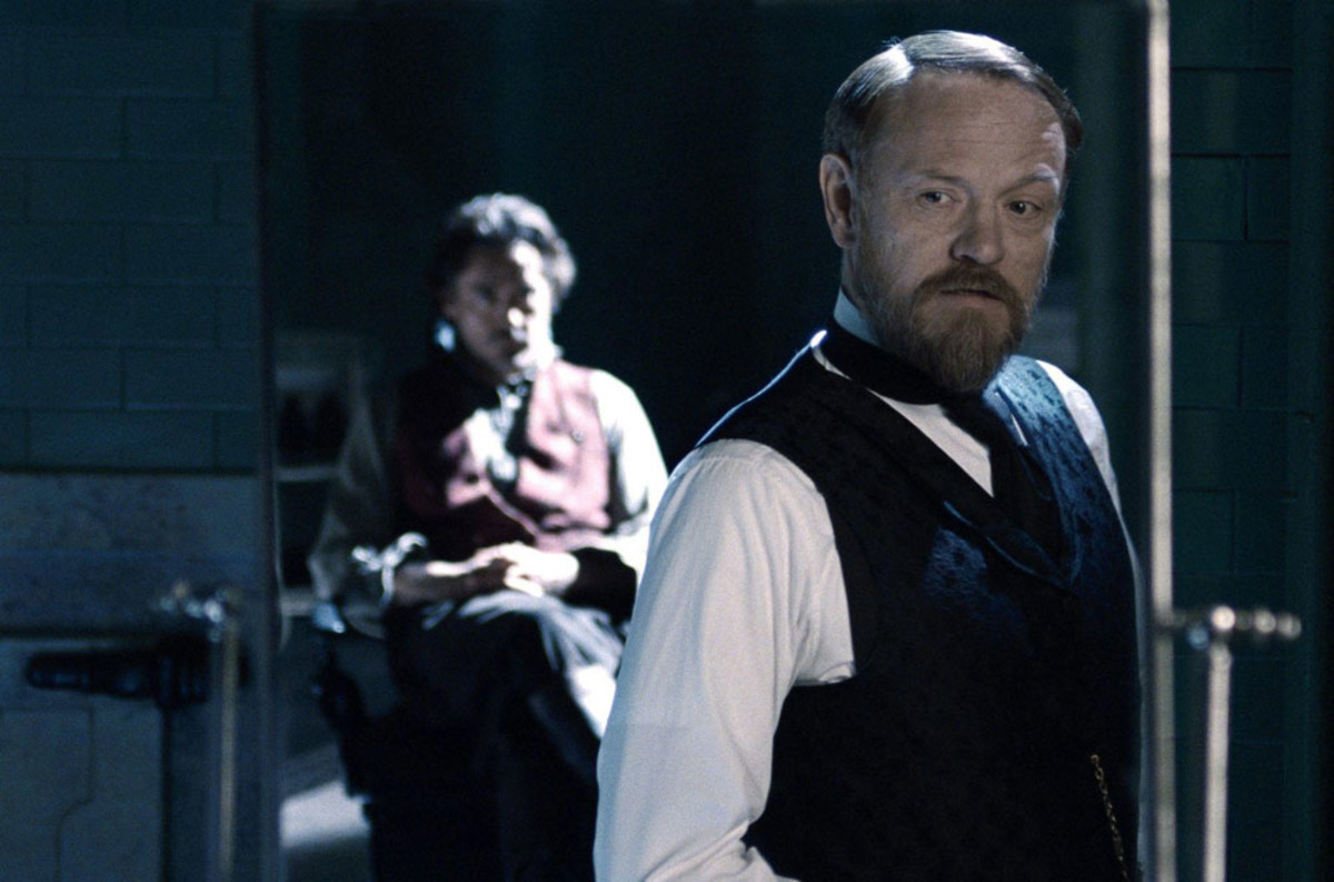 Holmes (Downey Jr.) and Moriarty (Jared Harris)