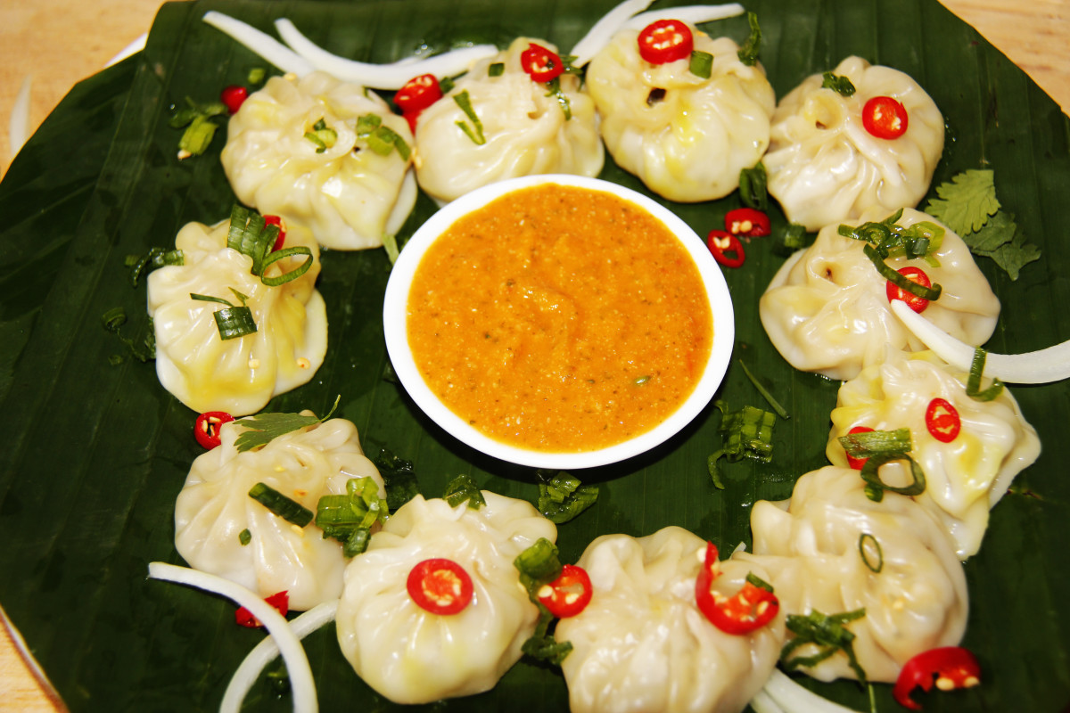 Nepalese style Momos/Dumplings served with Tomato chatney/sauce.