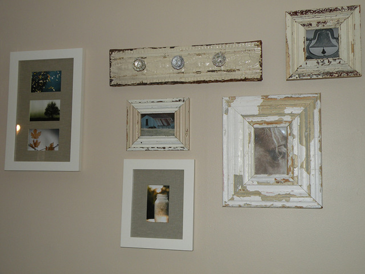 Plan your arrangement before hanging wall art.