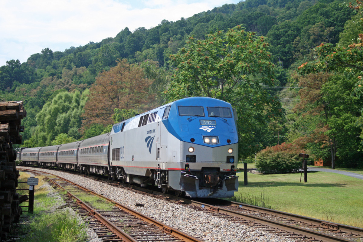 "Amtrak 192 ( a P42DC) leads ""The Cardinal"" through Afton, VA on its way to Charlottesville. Afton is near the top of the Blue Ridge mountains."