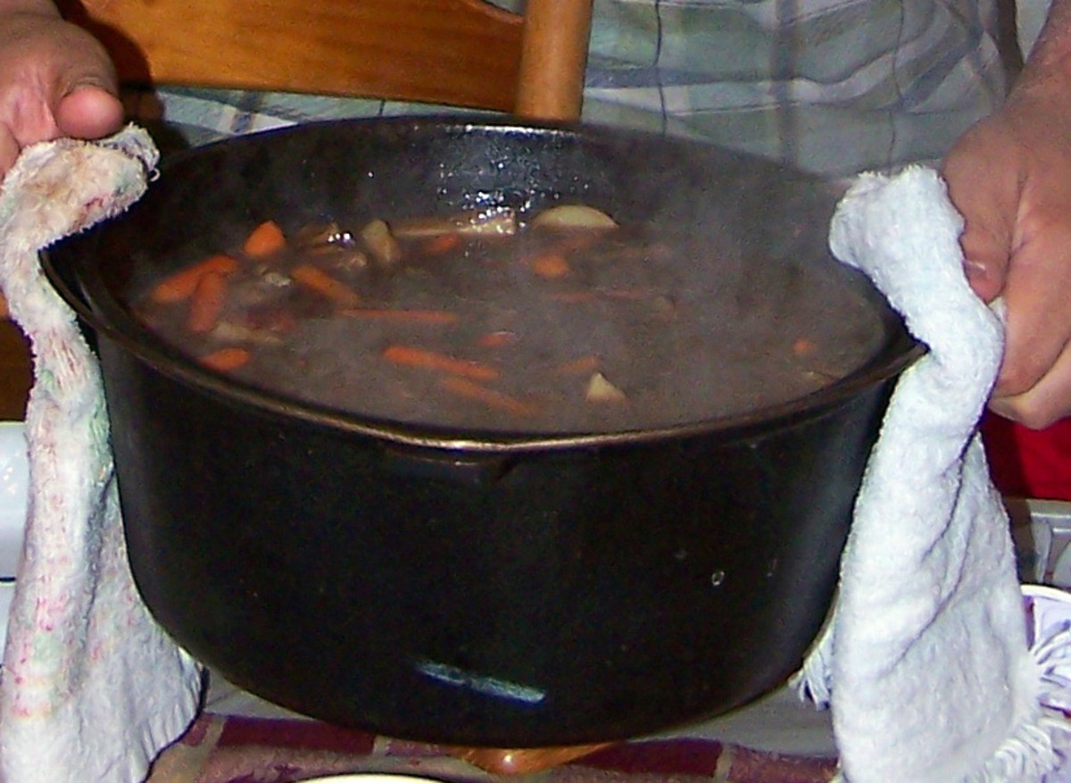 My husband ceremonially carries the cauldron of beef stew to the dinner table.