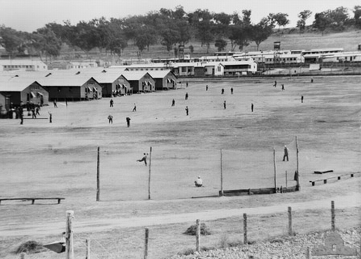 WW2: No. 12 Prisoner of War Camp, Cowra, Australia. 1 July, 1944. Japanese prisoners of war practice baseball on the sportsground near their quarters, several weeks before the Cowra breakout.