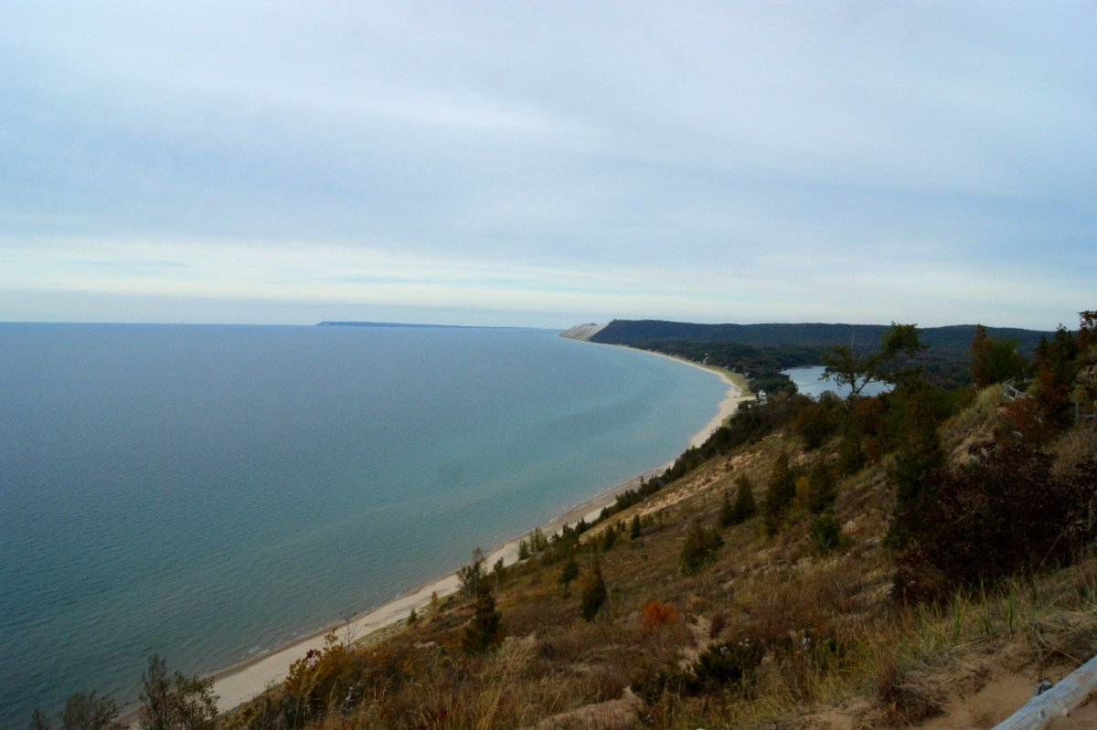 View of Lake Michigan, South Manitou Island and Sleeping Bear Dunes shoreline from the Empire Bluff Trail Overlook.
