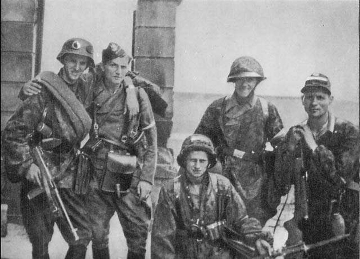"World War Two: Warsaw Uprising. Soldiers from Kolegium ""A"" of Kedyw on Stawki Street in Wola district. August 11, 1944."