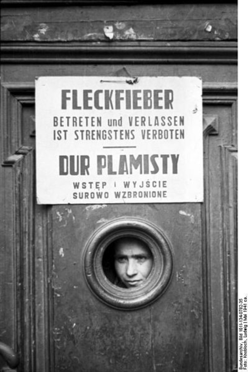 WW2: Poland, Warsaw ghetto. Boy looking through a door, under Typhus quarantine. Entering and leaving is strictly prohibited.