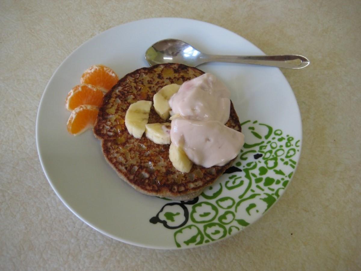Yummy vegan buckwheat pancakes served with mandarin, banana and soy yoghurt.