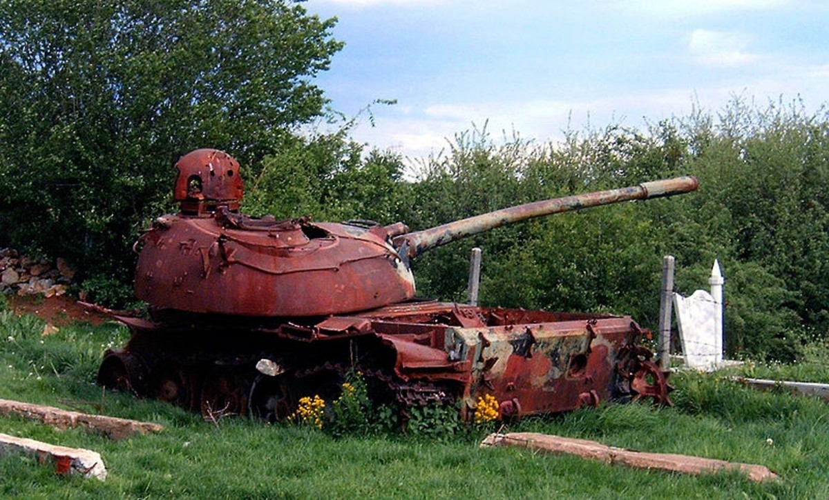 Soviet-built T-55-tank used by Serbian military lies in ruins near Prizren, Kosovo, years after the Serbs left. 2005.