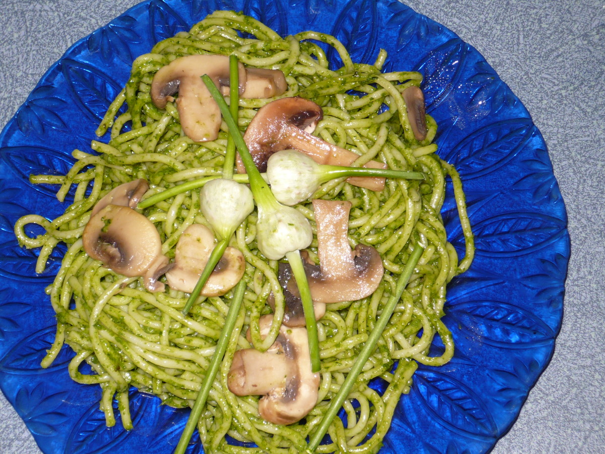 Spinach Pesto with Mushrooms and garlic scapes fried in Butter to top it off.