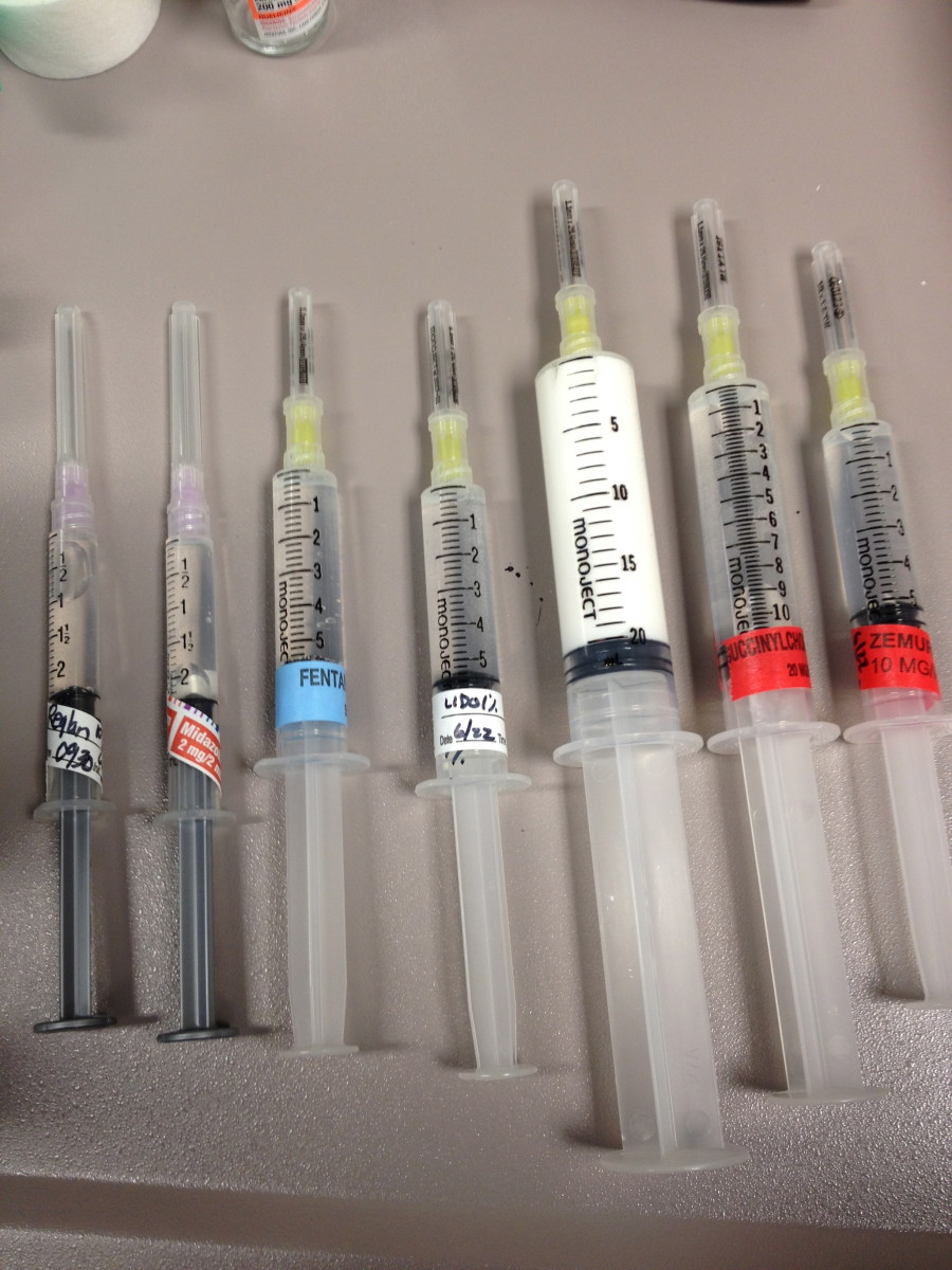 "Some of the intravenous medications that may be used during general anesthesia. Propofol is shown in the white syringe. Because of its color and ability to induce unconsciousness, it is has been given the nickname ""milk of amnesia."""