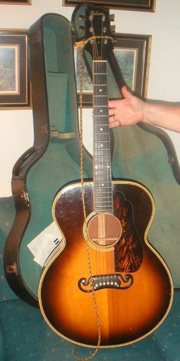 The Gibson J-100 Extra. Shown with a sunburst finish.