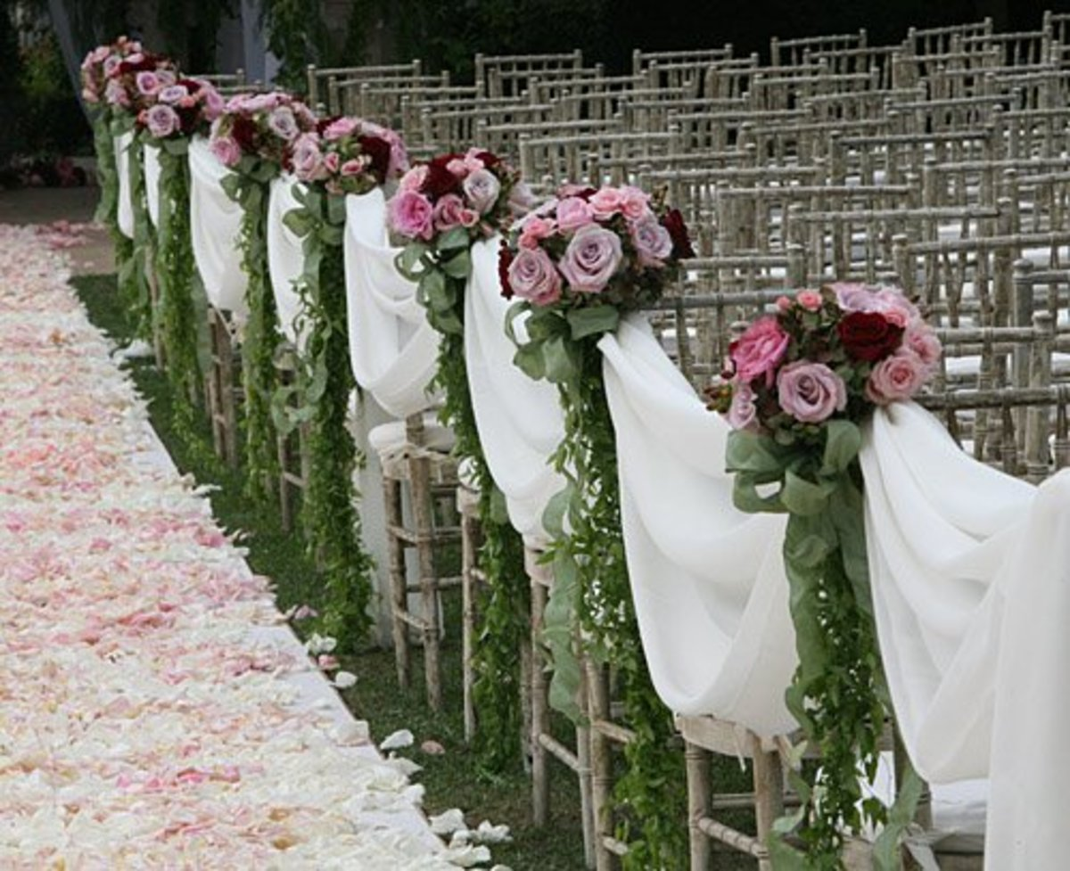 Pew bows, bouquets, and fabric drapes.